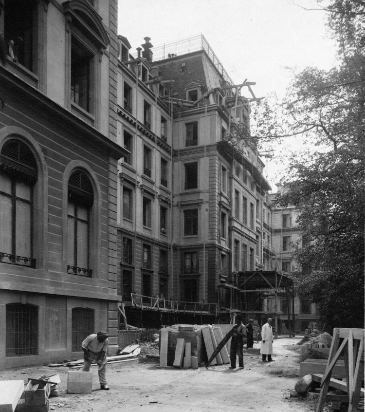The front of the Palais Wilson in process of being refaced from the Rue de Paquis - Copyright Boissannas Photographie